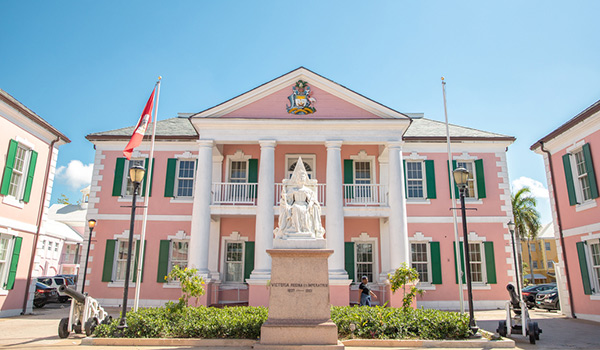 Pink colonial building with statue out front