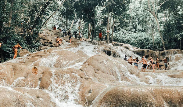 Group of people climbing up Dunn's River Falls