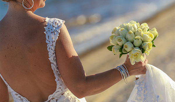 Bride holding a bouquet of yellow flowers