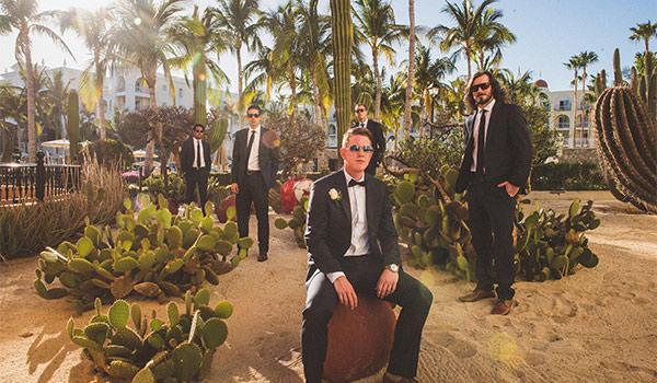 Groom and his groomsmen posing in a desert