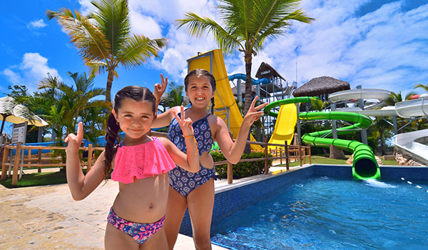 Two young girls standing in front of a water park