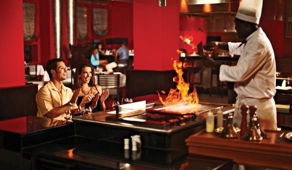 Couple watching a chef grill Teppanyaki style