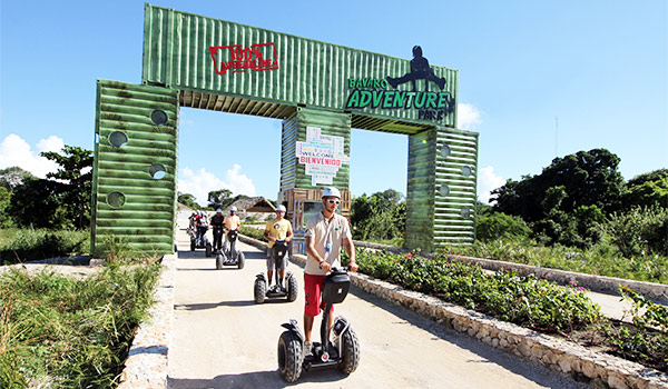 Group of people riding segways along a path