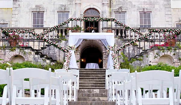 Old mansion coverd in ivy, set up for a wedding