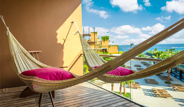 Hammock on a hotel balcony overlooking the ocean