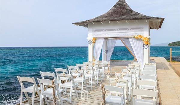 Wedding ceremony on a dock overlooking the ocean