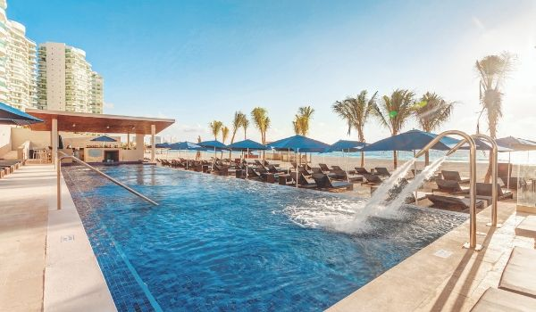 Infinity pool overlooking white-sand beach