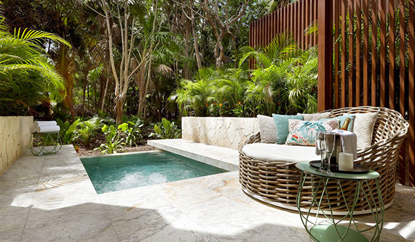 Patio with a private plunge pool surrounded by lush jungle landscapes