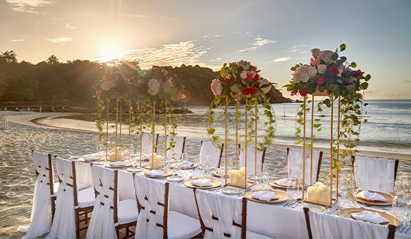 Elegant wedding reception on the beach at sunset