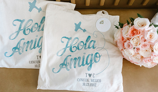 Tote bags beside a bouquet