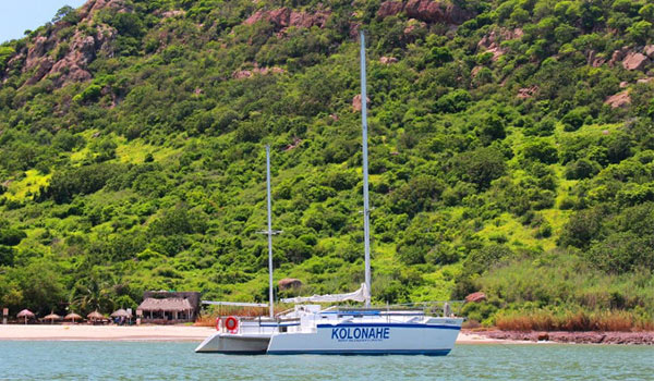 Boat anchored off the beach of a lush island