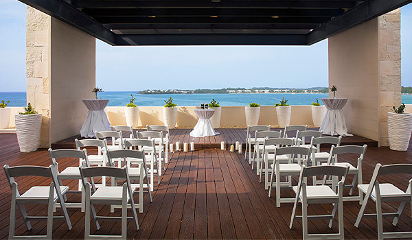 Wedding ceremony on a rooftop terrace overlooking the ocean