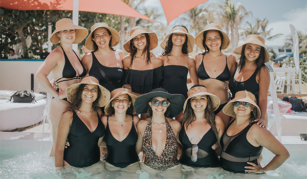 Group of women posing in the pool