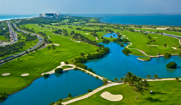 Aerial view of a golf course surrounding a lake