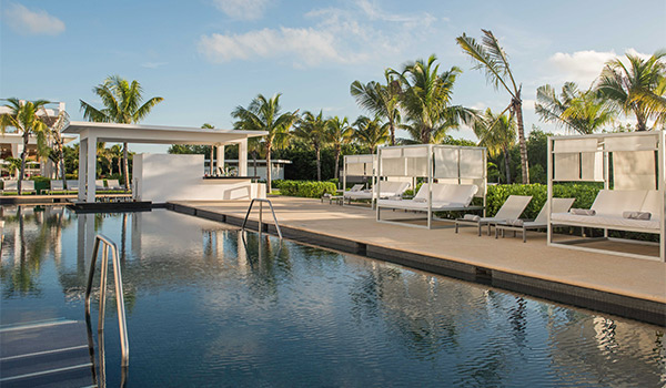 Relaxing-looking sun loungers by a serene pool