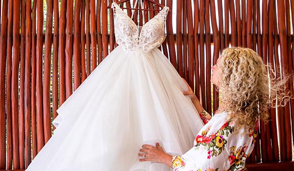 Bride looking at her wedding dress