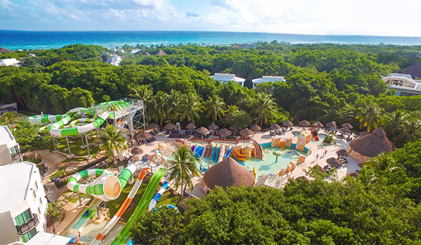 Aerial view of a water park with the ocean in the distance