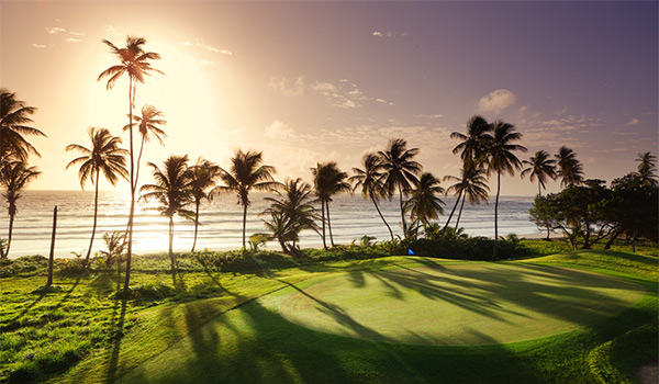Golf course overlooking the ocean at sunset