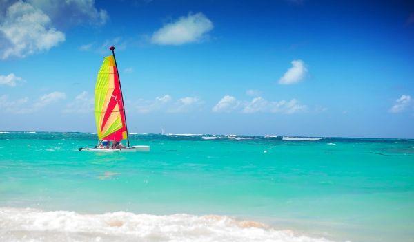 Catamaran cruising on bright blue waters