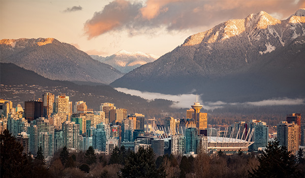 City skyline of Vancouver with mountains in the background