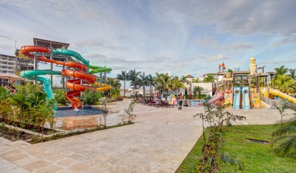 Big water slides on the left and mini kids splash pad on the right