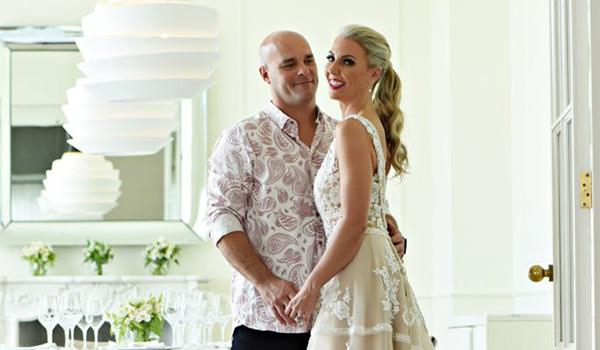 Bryan and Sarah posing in an elegant restaurant