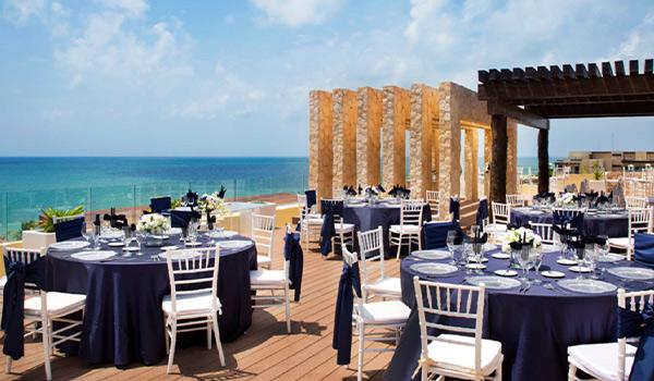 Wedding reception on a rooftop terrace overlooking the ocean