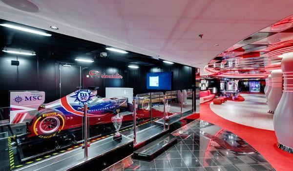 Formula 1 simulator surrounded by racing memorabilia