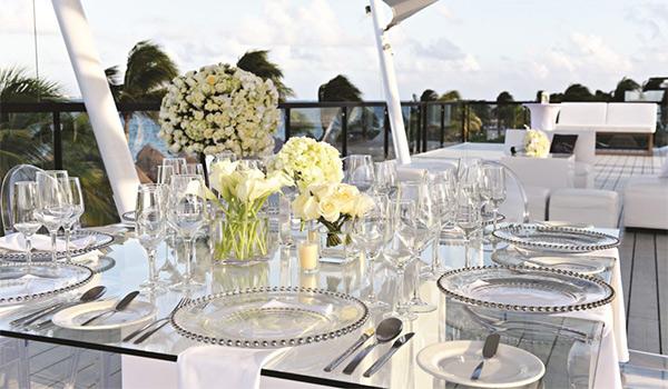Elegant tablescape at a rooftop wedding reception