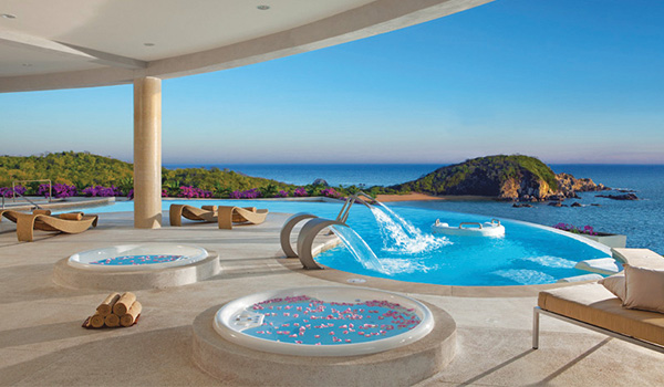 Hot tubs with rose petals and relaxing infinity pool overlooking the coast