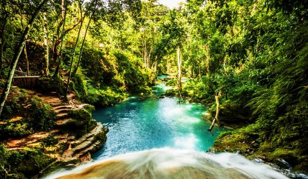 Tranquil pool and waterfall at Blue Hole