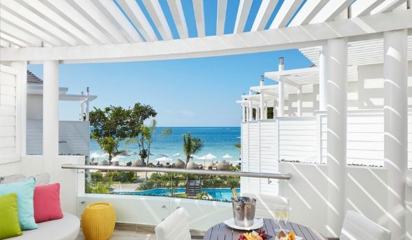 Balcony with infinity pool overlooking Negril Beach