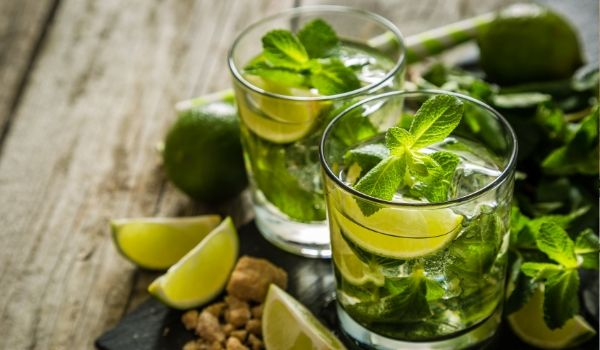 Pair of delicious mojitos on wood table