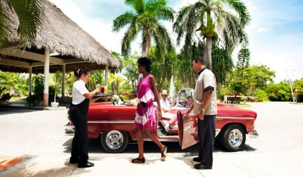 Couple getting out of a classic American car at the resort