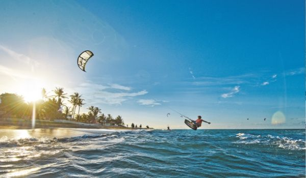 Kite surfer flying through the air over the ocean