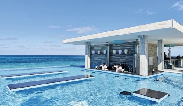 Sparkling infinity pool with a swim-up bar
