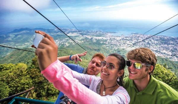 Three people taking a selfie during a cable car ride