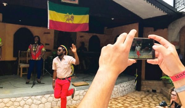 Man dancing under the Jamaican flag