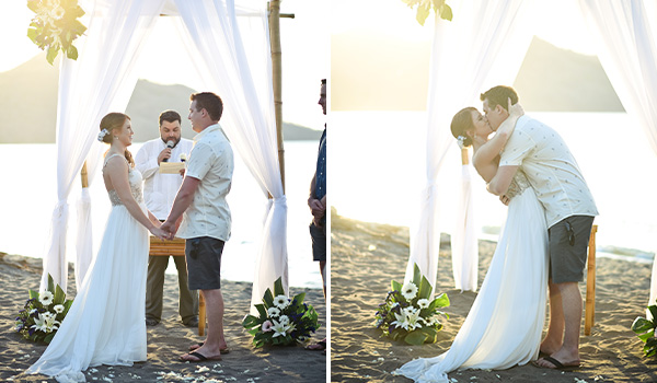 Bride and groom kissing at their wedding ceremony on the beach
