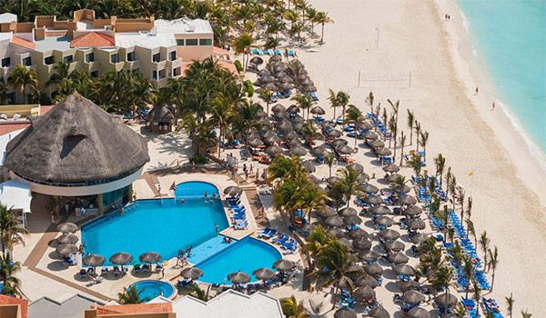 Aerial view of sparkling pool and beachfront at Viva Wyndham Maya