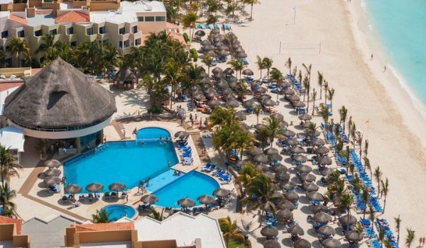 Aerial view of sparkling pool and beachfront at Viva Wyndham Maya