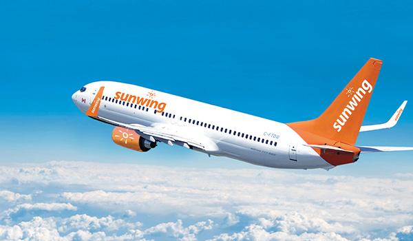 Sunwing plane flying through the sky