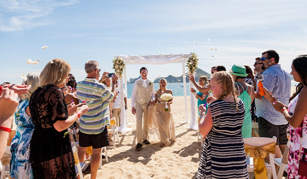 Bride and groom at their wedding ceremony on the beach