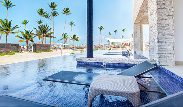 Lounger and side table in a swim-out pool overlooking the beach