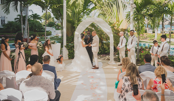 Groom and bride at their wedding ceremony in a beautiful garden