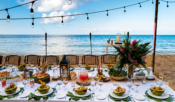 Table full of food on the beach