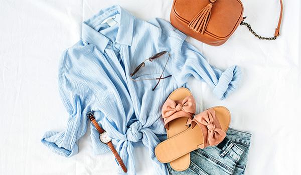 Overhead view of a shirt, flip flops and purse