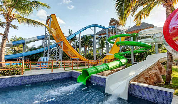 Pool at the bottom of two twisting water slides