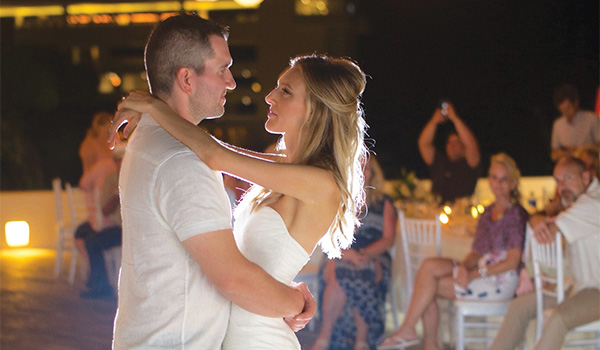 Couple dancing together on the beach