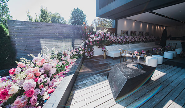 Outdoor terrace decorated with floral arrangements